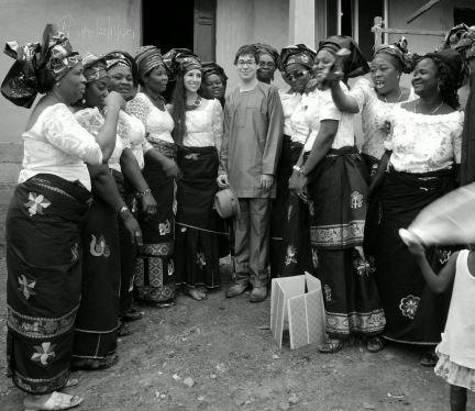 Clad in local garb, Rabbi Barry Dolinger and Naomi Baine pose with some of Abuja's Igbo Jewish women outside Gihon Synagogue. Photograph - Shai Afsai