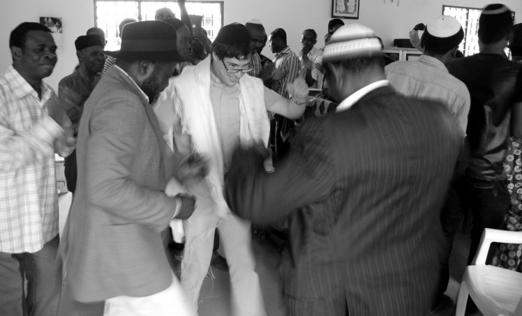 Following a talk at Abuja's Gihon Synagogue, Rabby Barry Dolinger joins in some festive dancing. Photograph -Shai Afsai