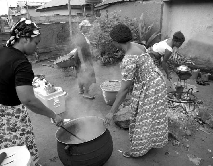 In preparation for Shabbat, Igbo Jewish women cook vast quantities of spicy rice. Photograph - Shai Afsai