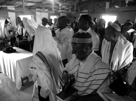 Morning prayers with Rabbi Barry Dolinger at Abuja's Tikvat Israel Synagogue. Photograph - Shai Afsai